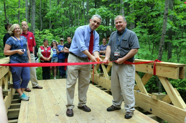 Picture of the Trail bridge built with the Lowe's funds and Bill Smith's Tech Trades Class.