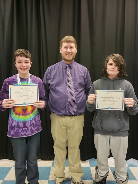 Pictured from left to right: Breckon Davidson, CMS social studies teacher Ryan Reed, and Max Sanborn.