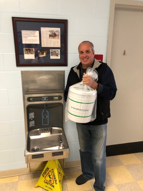 Mr. Hartzell standing next to the water fountain we purchased with his generous donation.