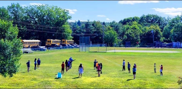 Students standing in outfield with 14 foot spacing