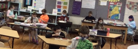 Fourth-grade students are combining rhythm and pitch to play melodies on glockenspiel.