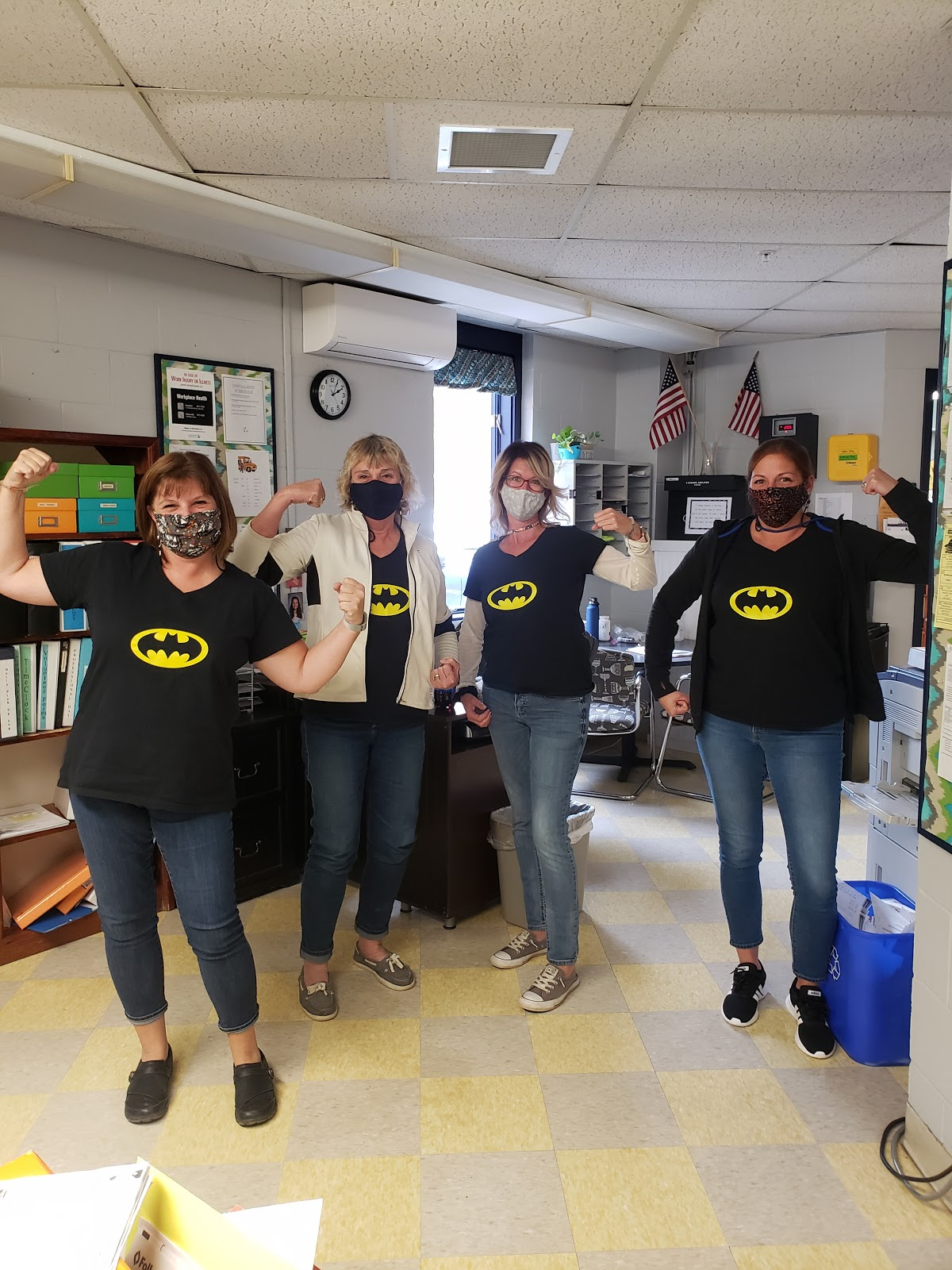 4 BCS staff members in protective masks wearing batman t-shirt on Superhero T-shirt day.